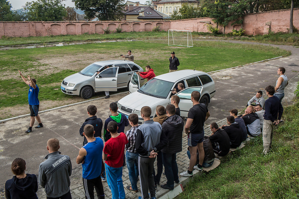 LVIV, UKRAINE - OCTOBER 5, 2015: Recruits take part in tactical training for new patrol police officers, learning how to apprehend a suspect during a traffic stop, in Lviv, Ukraine. In an effort to reform the notoriously corrupt Ukrainian police force, an entirely new force has been established in several cities, including Kiev and Lviv, with a primary focus on patrolling the streets. CREDIT: Brendan Hoffman for The New York Times