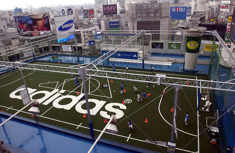 A soccer clinic, put on by Adidas, takes place on top of a Shibuya department store. Tokyo Japan World Cup..©David Dare Parker/AsiaWorks Photography