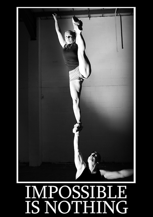 Motivational cheerleading poster of a single based partner stunt one armed lib with flyer doing a heal stretch. Caption underneath reads &quot; Impossible is nothing&quot;<br />
