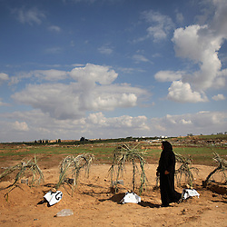 Subhia Al-Athamneh, 52, visits the grave of several of her family members killed by Israeli artillery fire, Beit Hanoun, Gaza Strip, Palestinian Territories, Nov. 16, 2006. Israel blames the deaths on a targeting error and expresses regret. According to Human Rights Watch, since September 2005, Israel has fired about 15,000 rounds at Gaza while Palestinian militants have fired around 1,700 back.