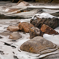 WA10019-00...WASHINGTON - Colorful rocks along the ice covered banks of the South Fork Snoqualmie River along the Franklin Falls Trail in Mount Baker-Snoqaulmie National Forest.