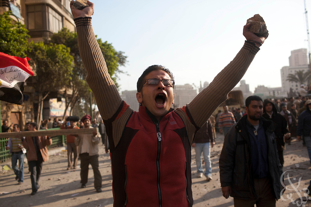 An anti-Mubarak protester cheers after repelling one of several  charges by lines of pro-Mubarak protesters on the edge of Tahrir Square February 02, 2011in Cairo Egypt. Both sides faced off today, battling for control of the square which has been at the center of more than a week of ongoing protests across Egypt..(Photo by Scott Nelson)