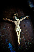 Crucifix on floor while a house is being repainted.
