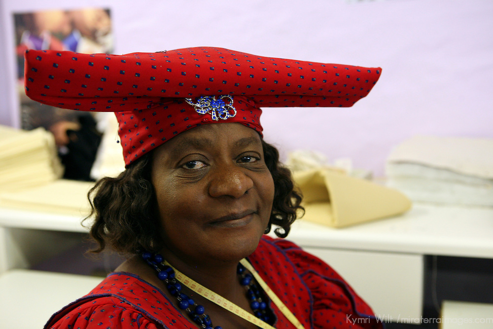 Africa, Namibia, Windhoek. A Herero woman in traditional colomial dress, working at Penduka development cooperation organization in Namibia.