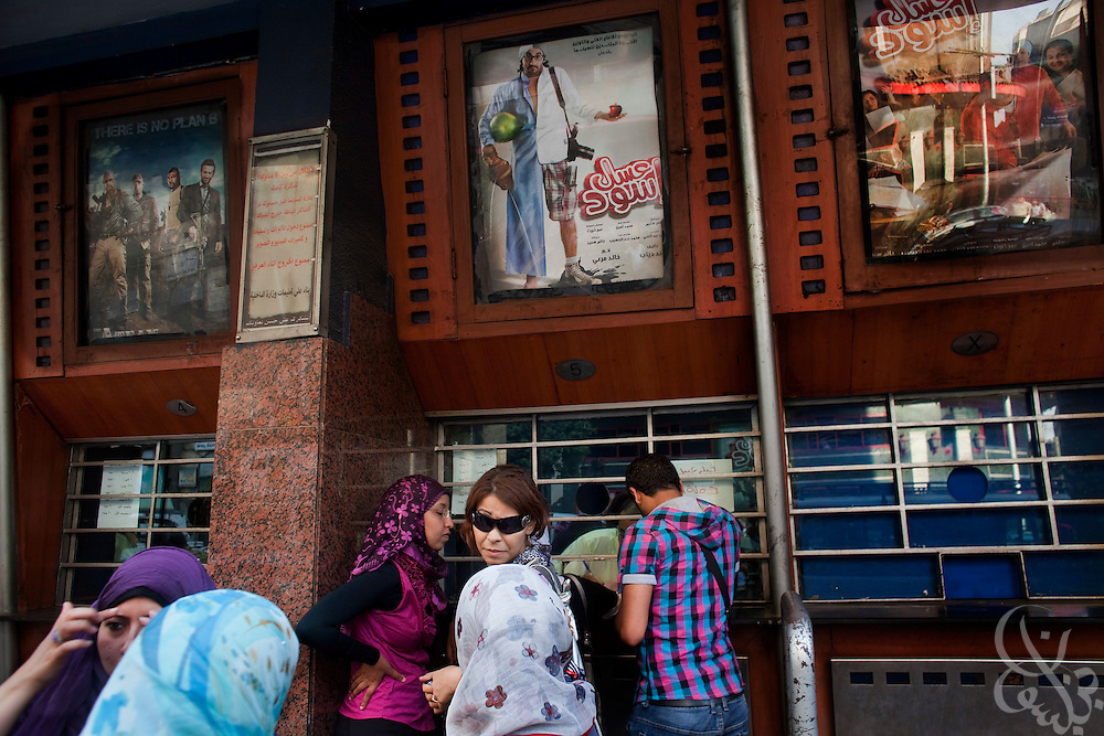"Egyptian movie goers buy tickets June 15, 2010 for the recently released film by Egyptian comedy star Ahmed Helmy entitled ""Asal Eswed"" (literally translated, ""Black Honey"") at a theater in downtown Cairo, Egypt. The film is a social satire that tackles  issues of national identity. (Photo by Scott Nelson for the National)"