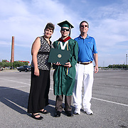 From left: Susan, Wilmington University graduate Brandon and Mike Martain pose for a photo after commencement exercises Sunday, May 17, 2015, at Chase Center On The Riverfront in Wilmington Delaware.