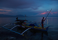 Full moon setting over Wasile Bay, Halmahera with pumpboat we used to travel from Foli to Labilabi along the Halmahera coast..Alfred Russel Wallace also travel around Halmahera by local boat.