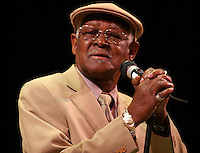 Grammy winner Ibrahim Ferrer sings during a concert performed at the Gran Teatro de la Habana, offered as a posthumous homage to Masters Ruben Gonzalez and Compay Segundo, Sunday September 19, 2004 in Havana, Cuba. They were all members of the Buena Vista Social Club, the musical project headed by Ry Cooder that carries traditional Cuban music all over the world. (Photo/Cristobal Herrera)