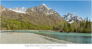 Composite panorama of the Chugach Mountains and Eagle River Valley at Echo Bend in Chugach State Park in spring in Southcentral Alaska. Afternoon.