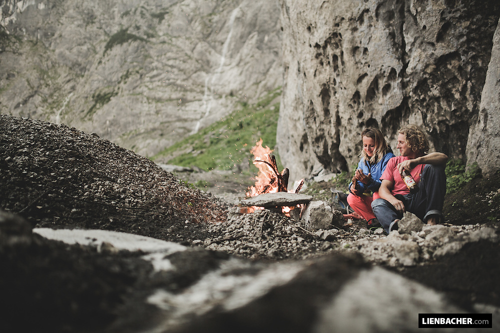Mich Kemeter and Hedi Friedl enjoy a campfire while they wait for the bad weather to pass.