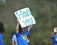Supporters of a $30 million school bond referendum hold signs at the Oxford Activity Center in Oxford, Miss. on Tuesday, October 26, 2010.