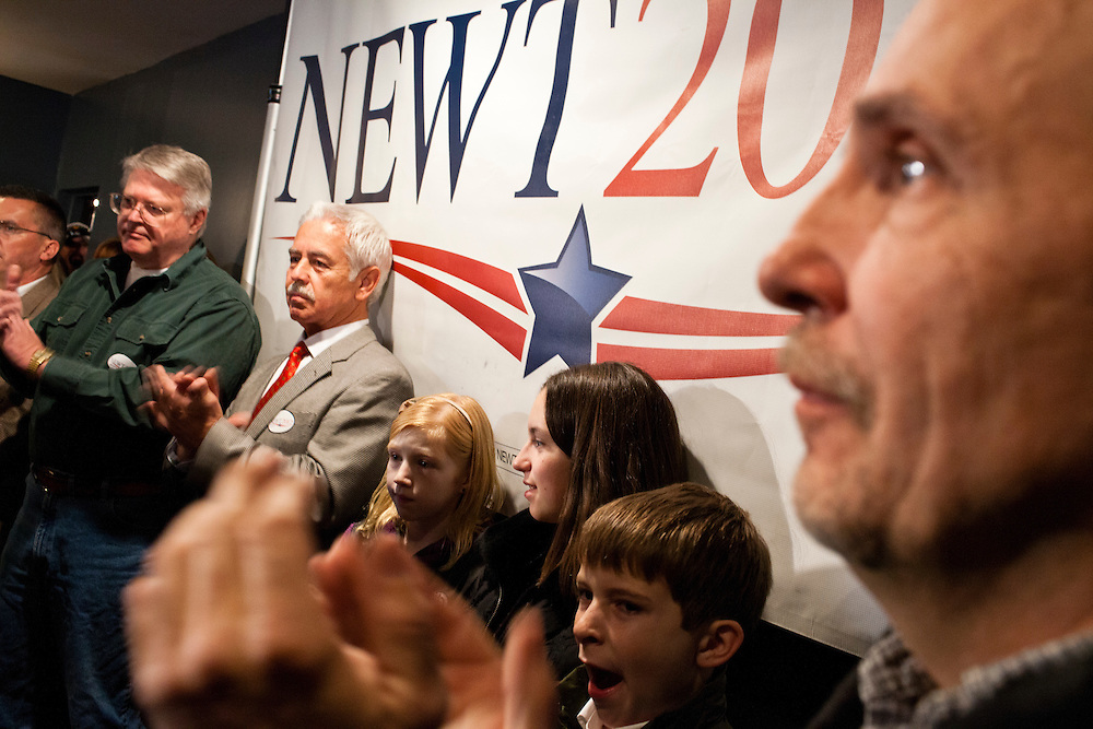 People applaud as Republican presidential candidate Newt Gingrich speaks at Tish's Restaurant on Saturday, December 31, 2011 in Council Bluffs, IA.