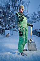 My neighbor, Wendy Isbell, shovels snow in alley behind her house, South Addition, Anchorage, Alaska