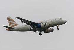 "London Heathrow Airport, November 16th 2014. A British Airways Airbus A319 in gold ""Dove"" livery, designed by Brighton-based designer Pascal Anson, prepares to land on runway 09L at London's Heathrow Airport."