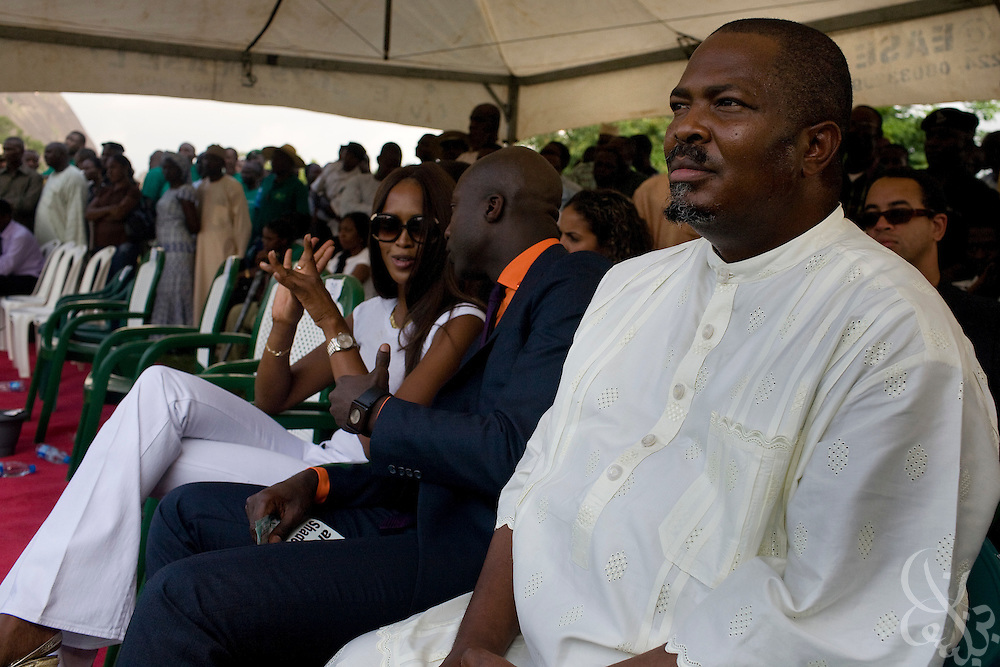 "ThisDay newspaper's Editor-in-chief Nduka Obaigbena (r), the organizer of the annual ThisDay Festival sits with celebrity guests super model Naomi Campbell and fashion designer Ozwald Boateng as they participate in a tree planting ceremony July 11, 2008 in Abuja, Nigeria. The 3rd Annual ThisDay Festival, themed ""Africa Rising"", is an effort to promote positive images of Africa by celebrating its' music, fashion and culture.."