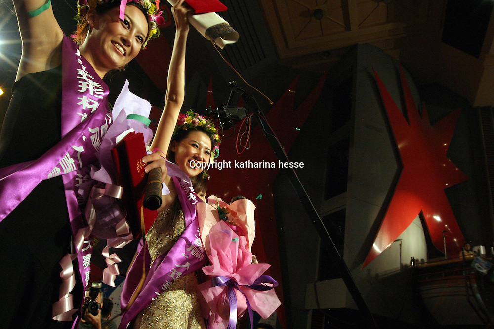 """BEIJING, 18 DECEMBER 2004: winners of  the """"first worldwide artificial beauty pageant """"  celebrate in a theatre in Beijing, 18 December , 2003, in China...Beauty business in China , from cosmetic surgeries to hair brush sales, has amounted to more than USD 7 billion in 2003. The contest for women who have undetgone plastic surgery was organized after Yang Yuan, a young would-be model, was disqualified earlier on this year when organizers discovered that she'd had plastic surgery. Yang was present during the contest to introduce her biography that explains why she has the right to """"improve"""" her natural features..."""