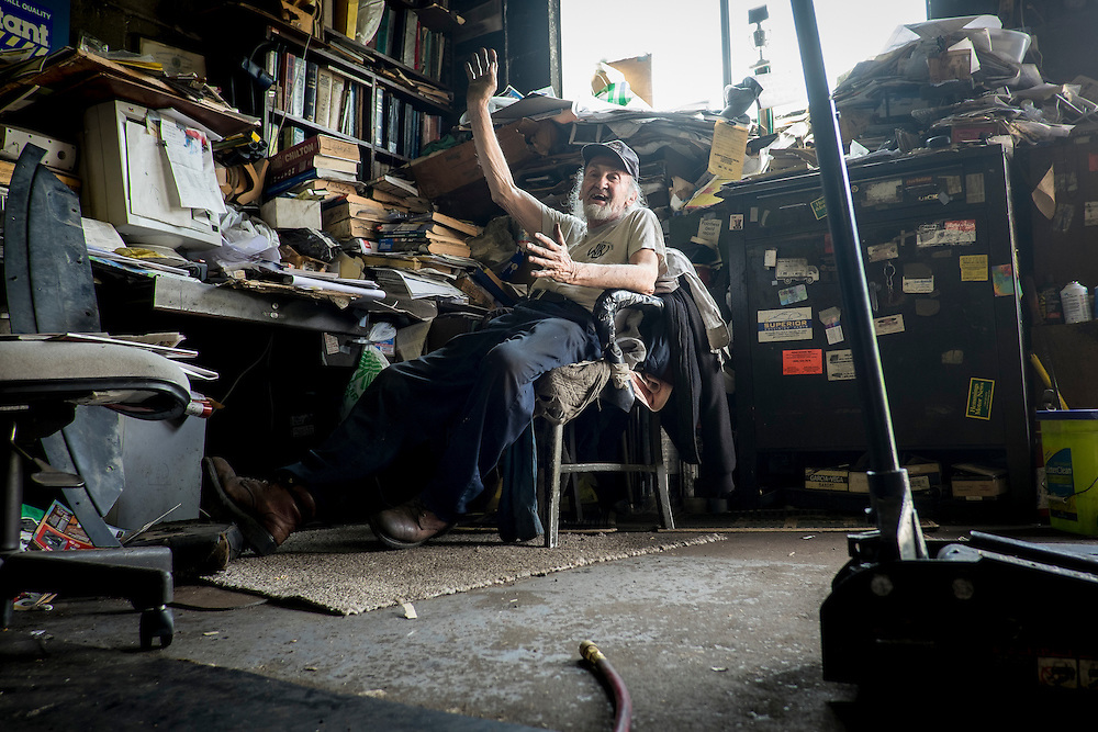 """Angelo """"Tubby"""" Galzarano, 79, in his repair shop, Tubby's Auto Service, in West Aliquippa, PA."""