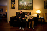 Chabela and Goya sit on a sofa inside an old people home in Bilbao. Chabela, from Bolivia, comes every afternoon to visit Gregoria Molina, known as Goya. They talk, walk around the residency when it is raining or go out for a coffee when the weather is good. Goya lives in an old people's home and Chabela like many other Latin American carers is employed by Goya's family to take care of her. Chabela has been with Goya for four years now.