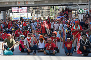 """""""Red Shirt' supporters taunt police and military forces on the streets of Bangkok...Violence between the 'Red Shirts' of the UDD and police / government military forces on the city streets of Bangkok. The UDD (United Front for Democracy Against Dictatorship) says Prime Minister Abhisit Vejjajiva came to power illegitimately and is a puppet of the military. The movement is made up of supporters of former Prime Minister Thaksin Shinawatra who was ousted in a coup in September 2006. The UDD wants Mr Abhisit to resign and call fresh elections."""