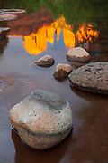 Cathedral Rock reflects in the calm waters of Oak Creek. Sedona, Arizona.