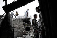 SYRIA, ALEPPO. Syrians inspect the remains of destroyed houses following an airstrike by the Syrian airforce in the northern Syrian city of Aleppo. ALESSIO ROMENZI