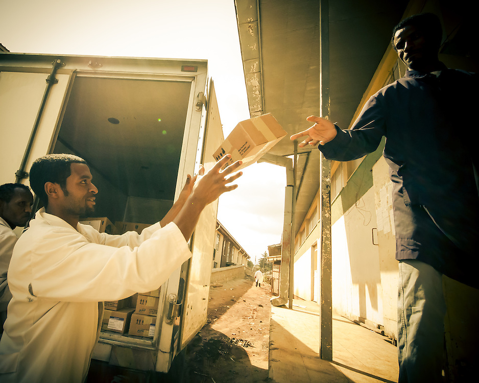 Staff huriedly pack a truck with boxes at a medical supplies distribution center in Addis Ababa, Ethiopia.