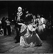 Oaxaca, Mexico.<br /> <br /> Family and friends celebrating Dia de Muertos in Oaxaca, Mexico. The holiday, celebrated through may other regions in Latin and South America focuses on family and friends honoring the deceased through symbolic gestures such as favorite foods, beverages, marigolds, decorated skulls and fancy dress parades in towns and villages.
