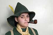 Israel, Purim, Young Teen girl of 15, dressed up as Snufkin a character in the Moomin series of books by  Tove Jansson. Model Release Available