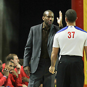 Springfield Armor Head Coach Doug Overton seen disputing with official Matt Myers (37) in the second half of a NBA D-league regular season basketball game between the Delaware 87ers (76ers) and the Springfield Armor (Nets) Saturday, Dec. 28, 2013 at The Bob Carpenter Sports Convocation Center, Newark, DE