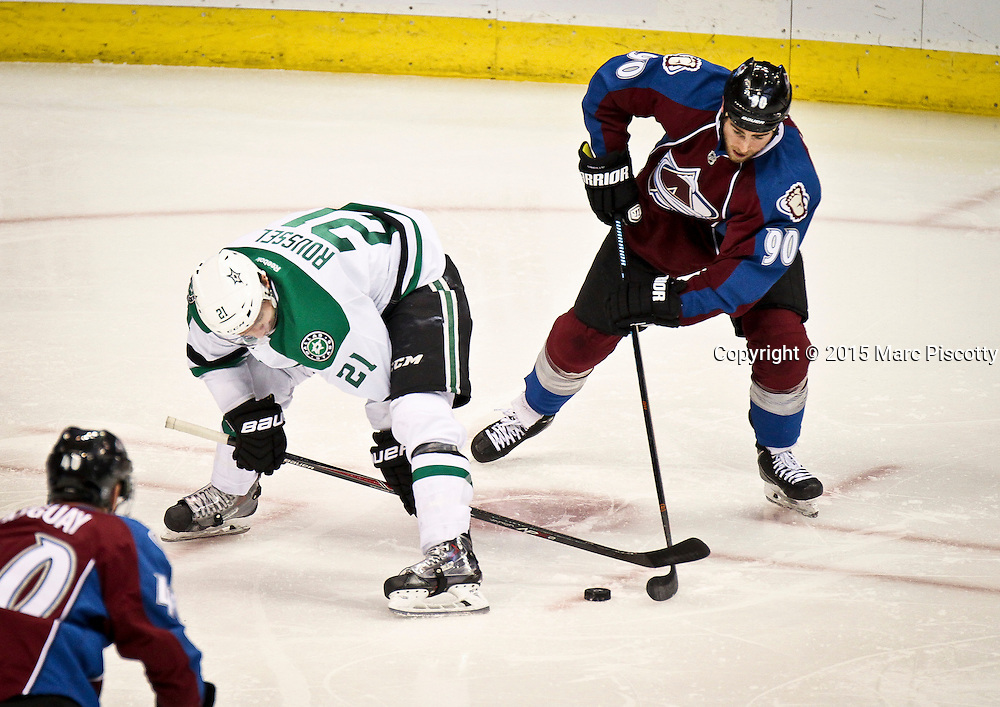 SHOT 1/10/15 2:04:30 PM - The Colorado Avalanche's Ryan O'Reilly #90 steals the puck from the Dallas Stars' Antoine Roussel #21 during their regular season game at the Pepsi Center in Denver, Co. Colorado won the game 4-3.  (Photo by Marc Piscotty / © 2015)