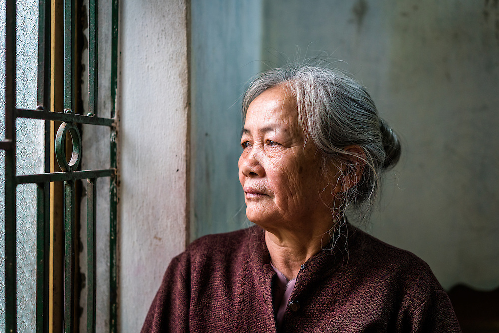 Hoa, 68, in portrait in her home in Doi Son village, Ha Nam Province, Vietnam. She was diagnosed with diabetes 3 years ago and suffer several complications, including hypertension.