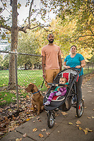 """""""If I could change one thing in the world...I would rather see people willing to listen than and less willing to act.""""   -Ian Brooks with his wife, Megan,  one year old daughter, Remy, and rescue dog, Bowie, on Cedar Street in Calistoga."""