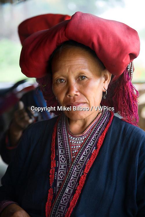 Red Dzao ethnic woman in Ta Phin village.<br /> Sapa, Lao Cai province, Vietnam