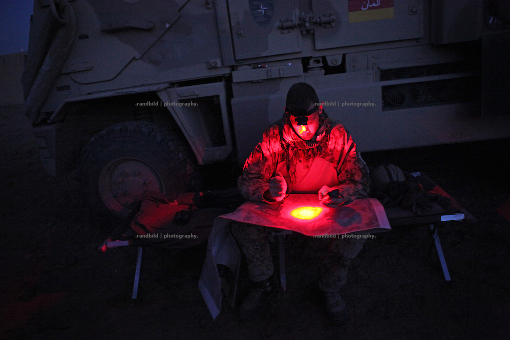 A Sergeant checks a map in the dark. In late October 2011 Kunduz based 3.Task Force started a several days operation in and around Nawabad (District Chahar Darah), west of Kunduz, northern Afghanistan. During the Operation Orpheus about 100 german infantery soldiers rolled out for patrols through the town and surrounding areas, which were expected as a retreat zone of insurgents.