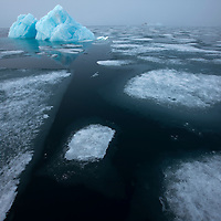 Norway, Svalbard, Nordauslandet, Glacial iceberg and floating pack ice in Lady Franklin Fjord