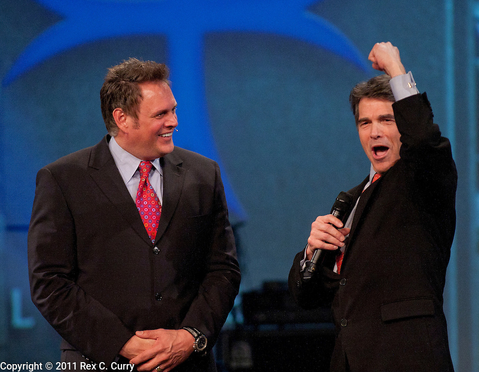 Texas Gov. Rick Perry, right, appears on stage with Pastor Keith Craft of the Elevate Life Church in Frisco, Tx. on Jan 10, 2010.  While running for re-election for governor, Perry, said he wasn't interested in becoming president.  He is said he is considering running in 2012.