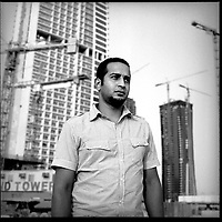 "Rami Galal, 24, from Egypt. He has lived in Dubai for a year and works in construction.""When I was in Egypt everything was up in the air. I had no purpose. I would go to work, come home, change, eat and go out with my friends. Now I have a much clearer purpose. Egypt was not good to us."" August 2008."