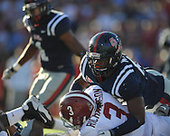 Alabama running back Trent Richardson (3) rushes is tackled by Ole Miss' Mike Marry (52) at Vaught-Hemingway Stadium in Oxford, Miss. on Saturday, October 14, 2011. Alabama won 52-7.