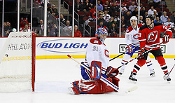 Jan 21, 2008; Newark, NJ, USA; New Jersey Devils defenseman Johnny Oduya (29) scores a goal past Montreal Canadiens goalie Carey Price (31) during the second period at the Prudential Center.