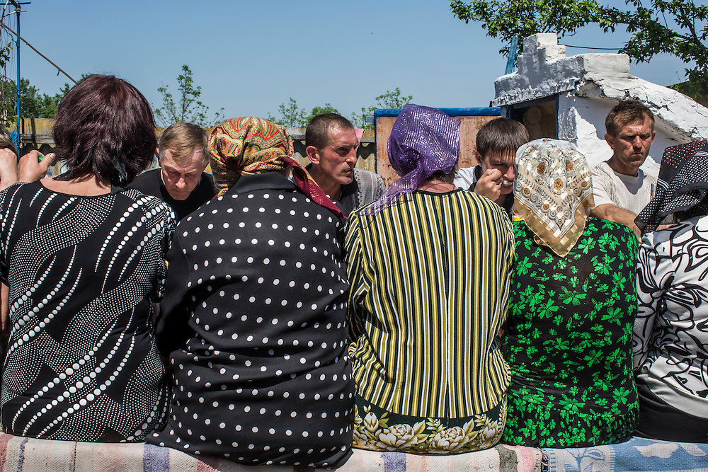 STAROVARVAROVKA, UKRAINE - MAY 16:  Mourners share a communal meal following the funeral of Elena Ott, 42, on May 16, 2014 in Starovarvarovka, Ukraine. Ott was killed two days prior when the car she was riding in was fired on by forces her family believes to be the Ukrainian military. (Photo by Brendan Hoffman/Getty Images) *** Local Caption ***
