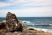 Bondi Sandstone wind and sea-sculpted boulder in the sea next to Coogee to Bondi beach Coastal path
