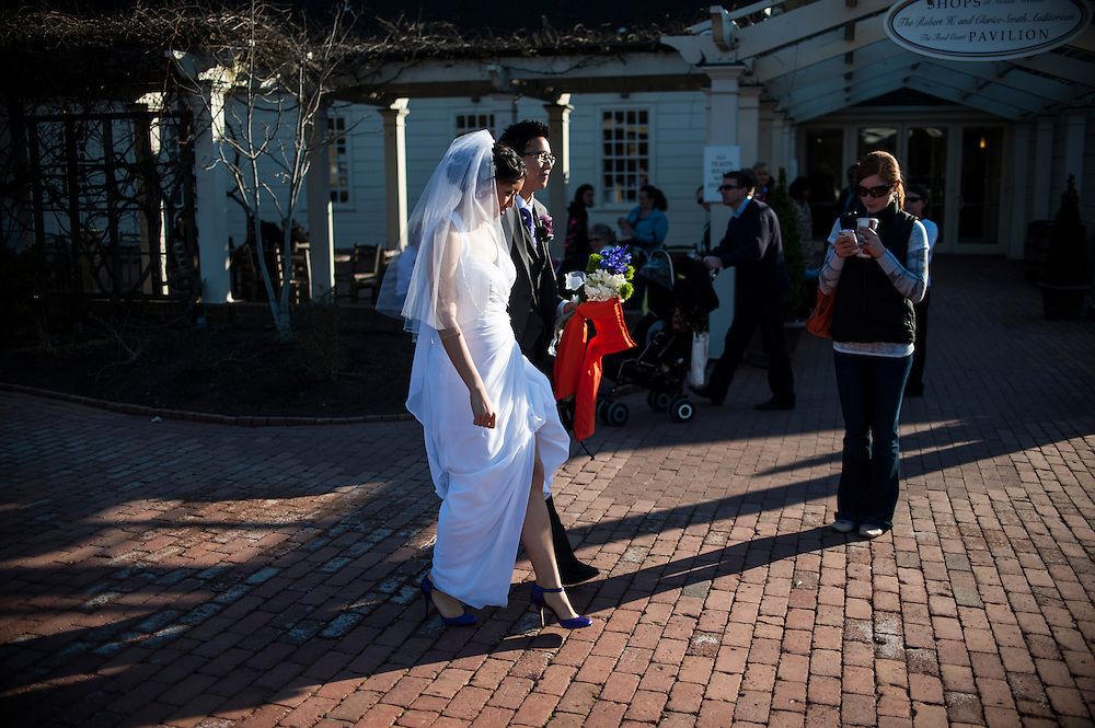 Photo by Matt Roth.Assignment ID: 30140754A..Evelyn Hsieh and Michael Wong walk past tourists at historic Mount Vernon Plantation in Virginia, towards the Mount Vernon Inn, where they are holding their reception Saturday, April 06, 2013.