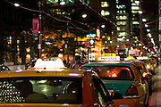 Taxis on King West, Toronto