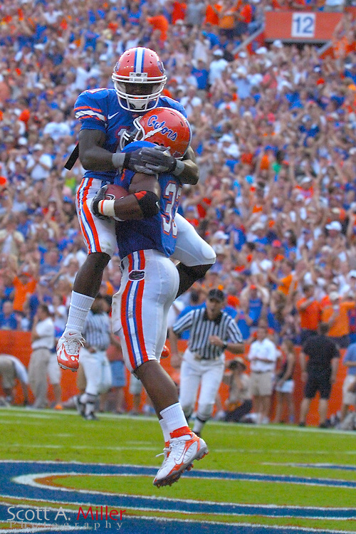 Sept. 9, 2006; Gainesville, FL, USA; Florida Gators running back DeShawn Wynn (21) celebrates with Moise Paul (33) after Paul's second quarter touchdown run against the Central Florida Golden Knights at Ben Hill Griffin Stadium. ...©2006 Scott A. Miller