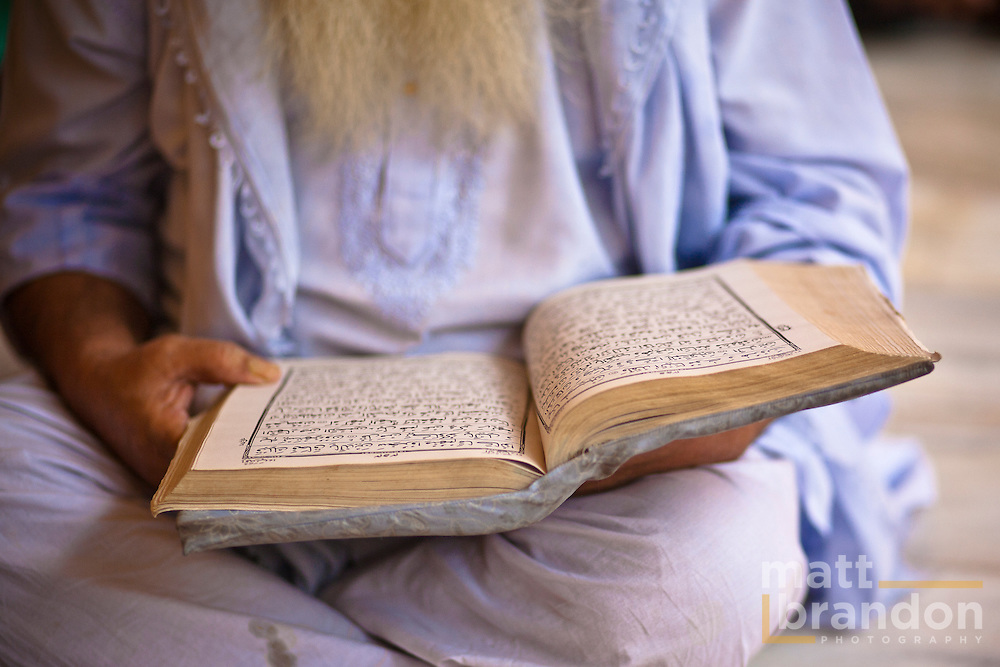 A man reads the Koran.
