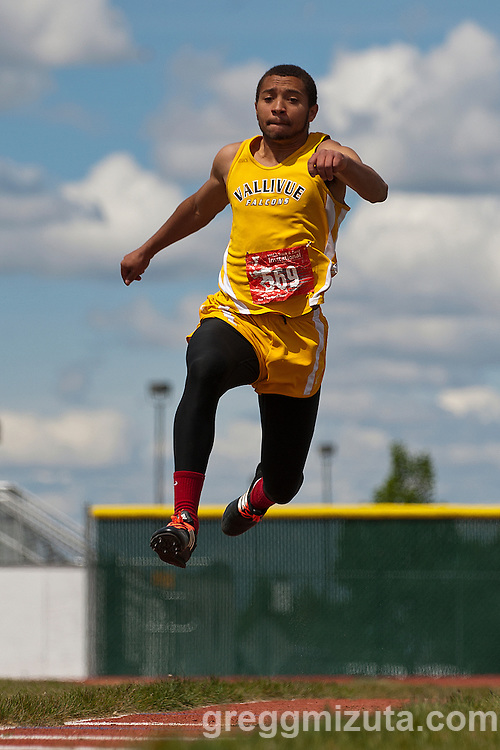 Vallivue sophomore Apolonio Arreola competes in the triple jump during the YMCA Track & Field Invitational at Mountain View High School, Meridian, Idaho. April 25, 2015. Arreola scratched on his attempts.