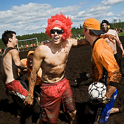 Team SSC Kilpentti and Team Koitelin Komiat after a tight game in the swampsoccer world championship in Hyrynsalmi, Kainuu 2011.