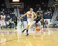 "Ole Miss's Marshall Henderson (22) vs. Coastal Carolina's Badou Diagne (23) at the C.M. ""Tad"" Smith Coliseum in Oxford, Miss. on Tuesday, November 13, 2012. (AP Photo/Oxford Eagle, Bruce Newman)"