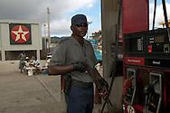 A gas station security guard in Cap Haitian, Haiti. January 27, 2008.