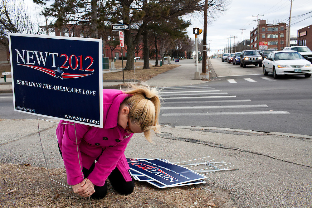 Karin Provencher, a campaign volunteer from Manchester, New Hampshire, puts out signs for Republican presidential candidate Newt Gingrich on Sunday, January 8, 2012 in Manchester, NH. Brendan Hoffman for the New York Times